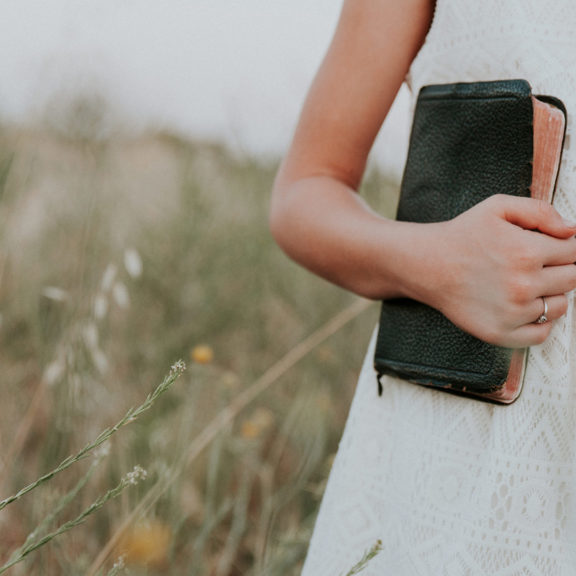 Girl-in-field-with-Bible